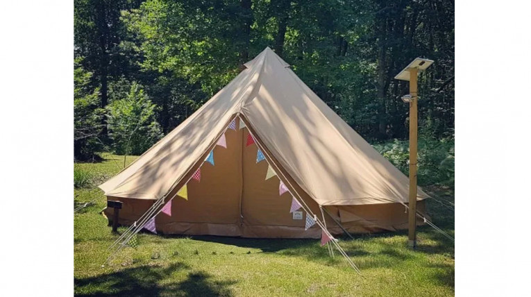 bell tent in woodland campsite